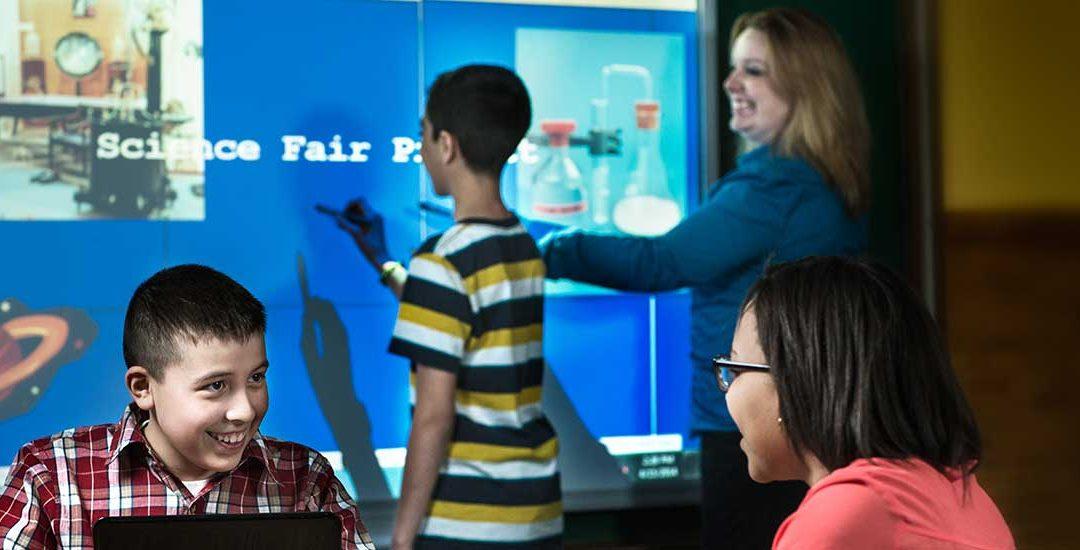 Students using SMART Board Interactive Displays